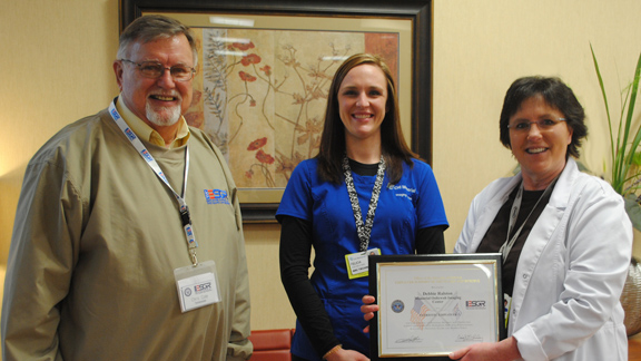 (l-r) Chris Cole, Employer Support of the Guard and Reserve (ESGR), along with Felicia Lane, CHI Memorial employee, present Debbie Ralston, CHI Memorial director, with the ESGR's Patriotic Employer Award.